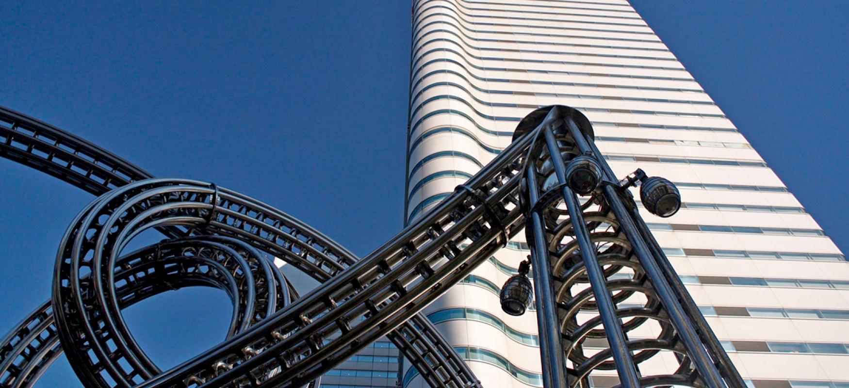 Part of a rollercoaster in front of an office building in Yokohama, Japan.