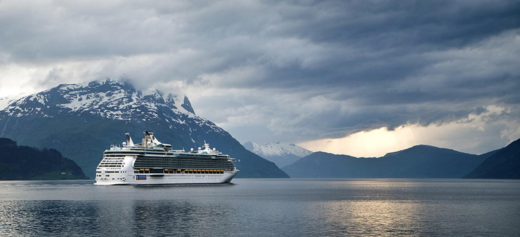 Cruise ship in a fjord.