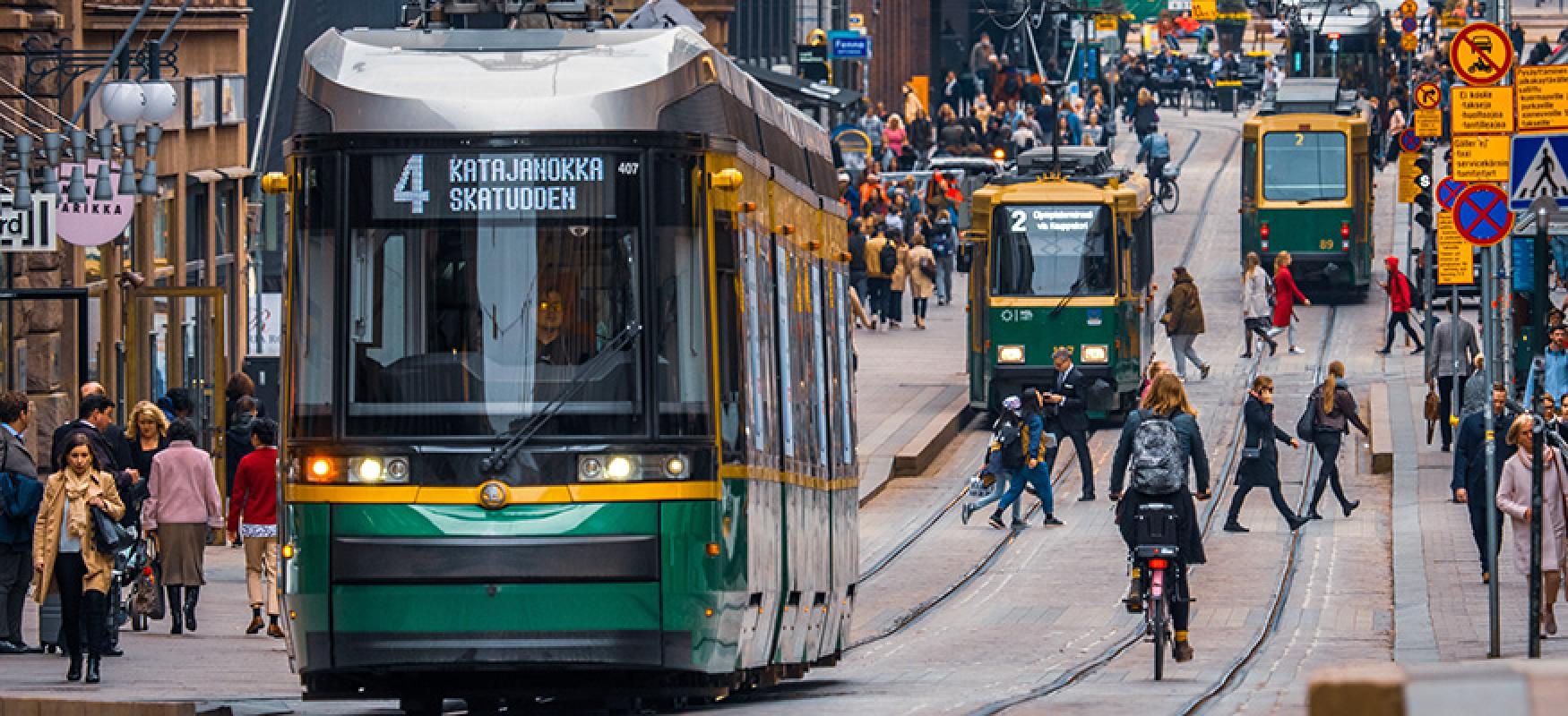 Trams and bikers in a city centrum.