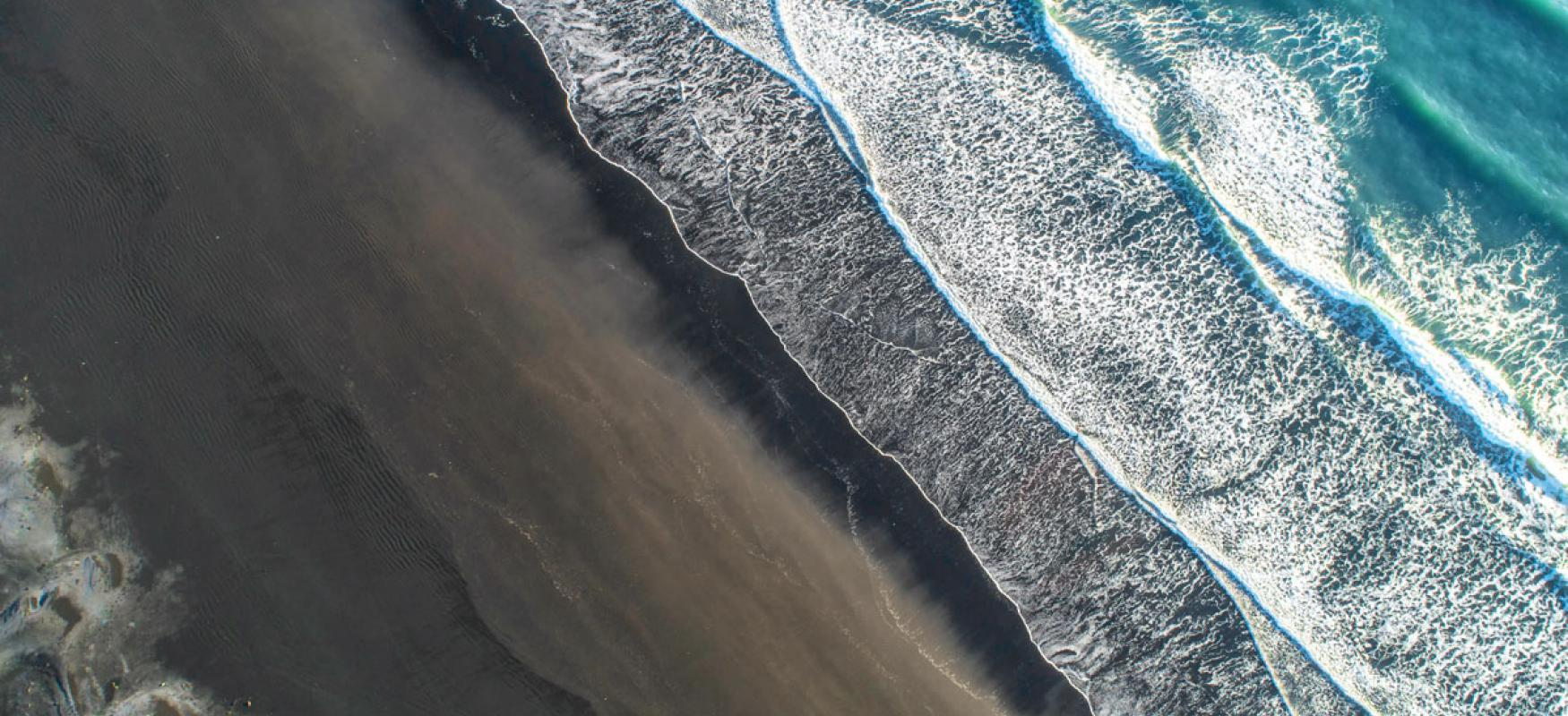 Areal view of waves washing in on a beach