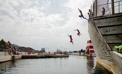 People jumping in the sea at the harbour bath at Islands Brygge in Copenhagen.