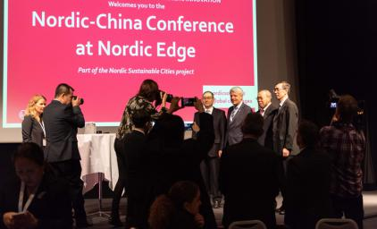 Chinese officials being photographed at the Nordic-China Conference