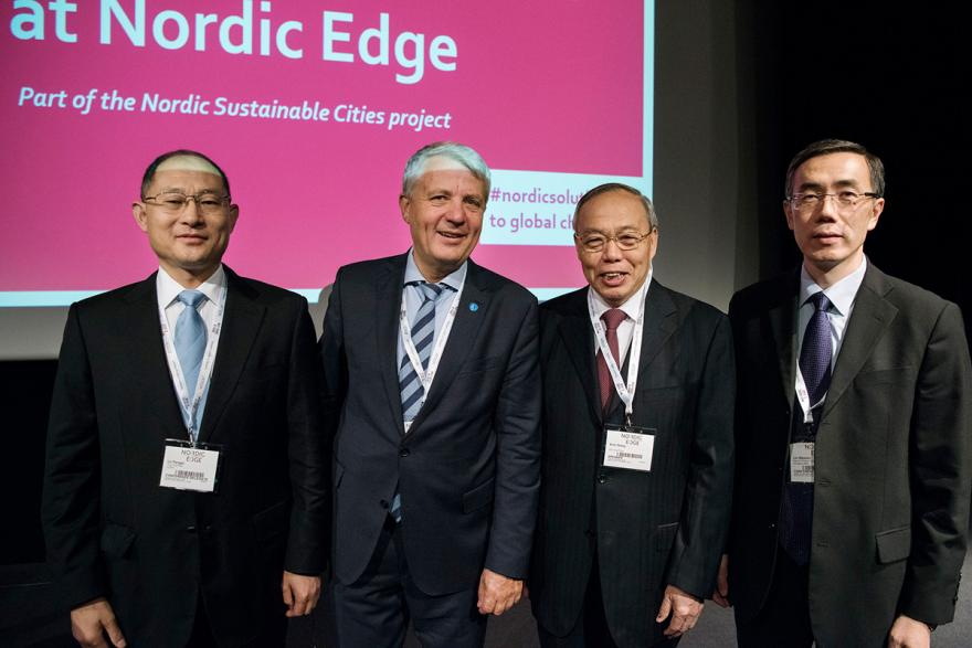 A group photo of Dr. Pengqi Lu, Mr. Dagfinn Høybråten, Professor Xinli Zheng and Mr. Liu Weimin.